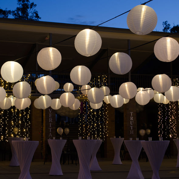 40cm illuminated white nylon lanterns (festoons from freemanshire.com.au)