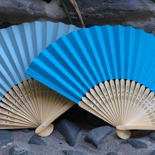 blue and bright blue paper fans