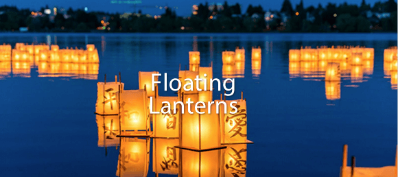Large floating bamboo/white paper lanterns with candles