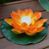 orange floating lotus flower with candle