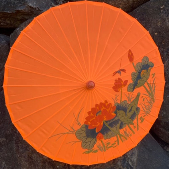orange dragonfly and lotus parasol