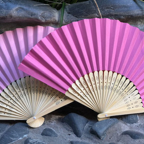 pink and dark pink paper fan