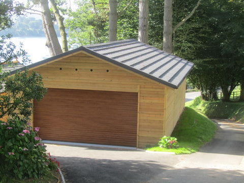 Completed installation 10.0m x 6.1m Triple Timber Garage with a 4.2m Aluminium Insulated Roller Garage Door in Golden Oak and a Metro Tile Roof