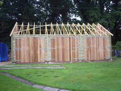 30ft x 20ft Triple Timber Garage with a 30 Degree Roof, Feather Edge Board and 3 Cedar Framed Double Garage Doors