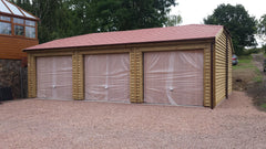 Triple Feather Edge Timber Garage with 3 Cedar Infill Up and Over Doors, a Half Hip Roof with Red Tapco Slate Roof