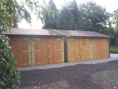 2 Sets of 5.5m x 5.5m Double Timber Garages with Brown Felt Tiles and Built to satisfy Planning Regulations at 2.5m to the Ridge