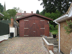 12ft x 20ft Single Timber Garage with a Set of Herringbone Double Doors, the Customer has Treated the Garage After Assembly.  This Garage was 7 Years Old When the Picture was Taken