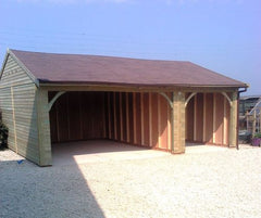 Triple Timber Garage with a Double and Single Cart Lodge Openings and Red / Brown Felt Tiles