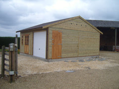 Double Timber Garage with an Up and Over Door to One Side and Georgian Doors and Windows to the Other