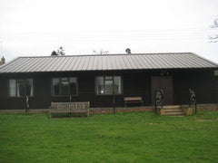 Large Club House with Rollaclad Black Metal Roof and Grey Anthracite Windows and Doors