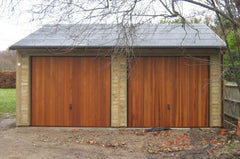 Double Timber Garage with Cedar Infill Up and Over Doors Under Eaves and Heavy Duty Green Mineral Felt