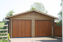 Double Timber Garage with Cedar Up and Over Doors in the Gable End