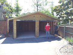 Double Timber Garage with 2 Up and Over Canopy Garage Doors in the Front Gable End
