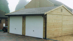 Double Timber Garage with Slate Grey Tiles and 2 White Up and Over Garage Doors Under the Eaves