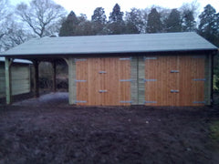 Double Timber Garage with 2 Sets of Standard Garage Doors and a Cart Lodge Opening to the Side