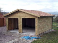Double Timber Garage with Cedar Shingles and Openings Left for the Customer to Install their own Garage Doors