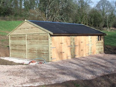30ft x 20ft Triple Timber Garage with 2 Sets of Double Doors, a Standard Garage Window and Personnel Door