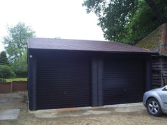 Double Timber Garage with 2 Up and Over Doors, Felt Tiles and the Customer Painted the Garage Black after Installation.