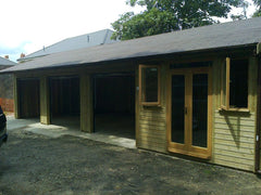 Quadruple Timber Garage with 3 bays, Up and Over Doors and a Garden Office in the 4th Bay.  Features Slate Grey Felt Tiles