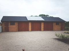 50ft x 20ft Quadruple Timber Garage with 3 Cedar Up and Over Doors, 2 Personnel Doors, NRC Recycled Tiles, the Customer Fitted their own Solar Panels