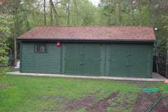 30ft x 20ft Triple Timber Garage with Cedar Shingles, 2 Sets of Double Doors and a Window.  Customer Painted the Garage After Installation