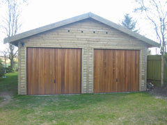 Double Timber Garage with Cedar Up and Over Garage Doors in the Gable End