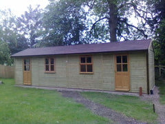 9.0m x 3.0m Work Room with Garden Office Doors and Windows, a Felt Tile Roof and the Building has been Split with a Partition