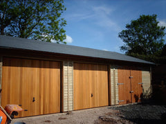 30ft x 20ft Triple Timber Garage with 2 Cedar Infill Up and Over Doors, a Set of Standard Doors and Slate Grey Felt Tiles