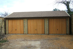Triple Timber Garage with 3 Cedar Up and Over Garage Doors and Cedar Effect Felt Tiles
