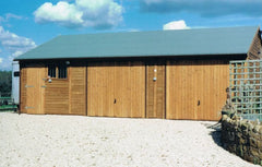 Triple Timber Garage with Heavy Duty Green Mineral Felt, 2 Up and Over Doors, a Standard Garage Window and a Personnel Door