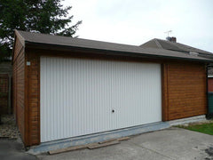 Large Double Timber Garage with White Metal Up and Over Door with Slate Grey Tiles