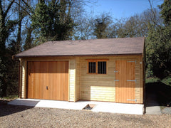 Recessed Double Timber Garage with Red / Brown Felt Roof and Cedar Infill Up and Over Garage Door