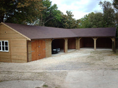 5 Bay Corner Timber Garage with 4 Cart Lodge Openings and a Closed Garage with Standard Timber Garage Doors and a Felt Tile Roof