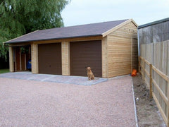 Triple Timber Garage with Brown Up and Over Metal Doors and Felt Tiles