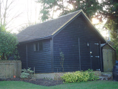 18ft x 24ft Feather Edge Double Timber Garage, 40 Degree Pitched Roof with Clay Tiles and a 14ft Motorised Timber Up and Over Garage Door