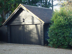 Double Timber Garage Finished in Black Feather Edge Cladding, 40 Degree Pitch Roof, Clay Tiles and a 14ft Wide Fully Motorised Up and Over Black Timber Door