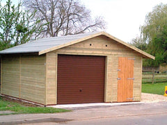 Wide Single Timber Garage with a Brown Up and Over Door, a Personnel Door and Heavy Duty Green Mineral Felt