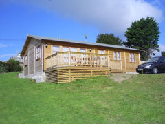 40ft x 20ft Log Cabin with Garden Office Doors and Windows. Customer Insulated Building to be used as a Holiday Let