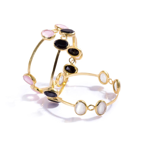 Beautiful gold plated bracelets from Bohème, a brand now based in Singapore. White, black onyx and pink agate are used to give a classy style.