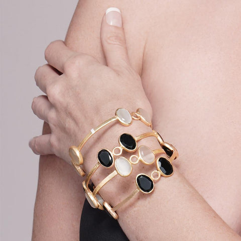 Beautiful gold plated bracelets from Bohème, a brand now based in Singapore. White, black onyx and pink agate are used to give a classy style, made in india, fashion photoshoot
