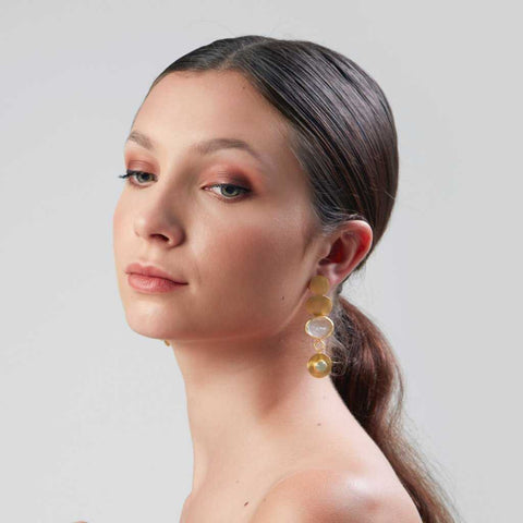 These cute and unique earrings made of gold plated sliver, with semi-precious stones such as Moonstones and Agate, from Bohème, a brand now based in Singapore, fashion photoshoot