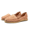 A Mexican flat-heeled sandal with an upper of woven leather strips, all handcraft from Louis & Goat.