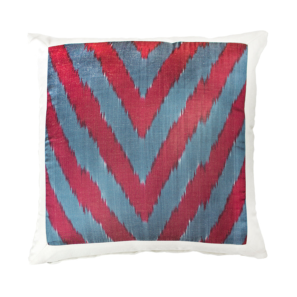 This beautiful cushion, is made out of silk Ikat which is hand woven in Uzbekistan. Using a similar dying technique to tie-dye, bindings, which resist dye penetration, are applied to the threads in the desired patterns and the threads are dyed. Alteration of the bindings and the dyeing of more than one color produce elaborate, multi-colored patterns. When all of the dyeing is finished the bindings are removed and the threads are ready to be woven into cloth.