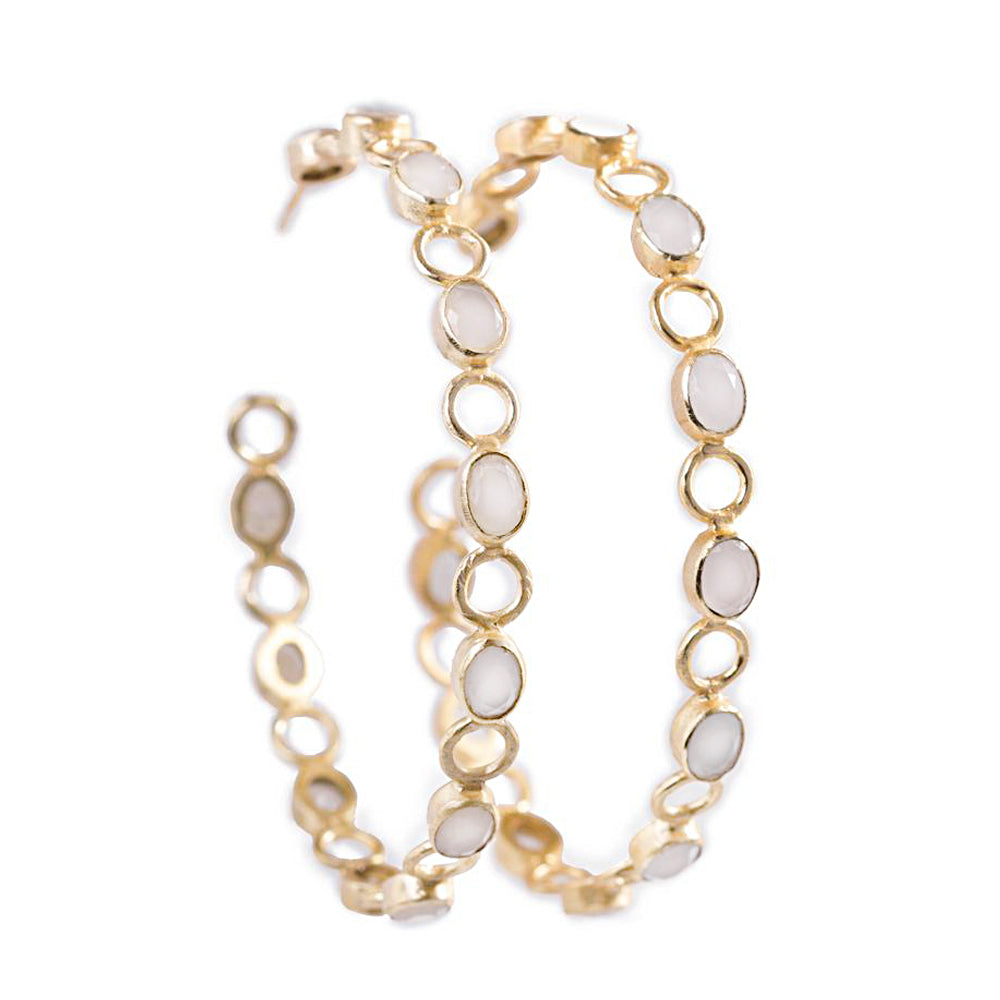 An unusual large hoop earrings from Bohème, a brand now based in Singapore. Moonstones are set on the hoops, make you stand out from the crowd.