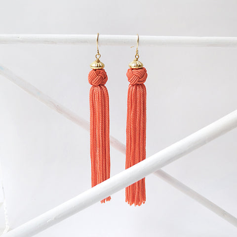 Colourful and fun these pink earrings have a Knot which cascades into a long tassel.  Great when you want to add some colour to your outfit.
