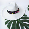 White Panama Hat with colourful weave pom pom beads great for summer Lifestyle picture
