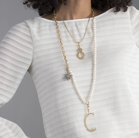 The Lulu Frost radiant charm features an Art Deco-inspired star motif that represents transcendence. Pair with one of the chain bases and add additional charms to create a special piece all your own.