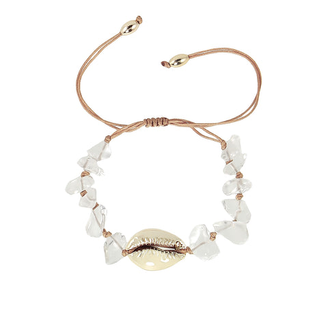 Gold plated shell bracelet with transparent lucite stones