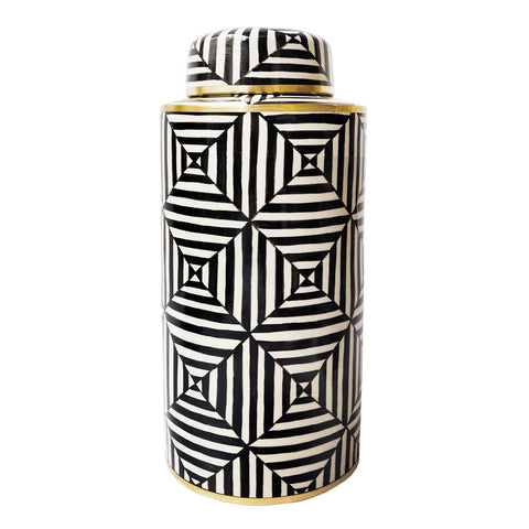 Striking geometric shapes and brass detailing make this black and white ginger jar a great decorative addition to your household.  A great vase as well.  Hand painted in Thailand.