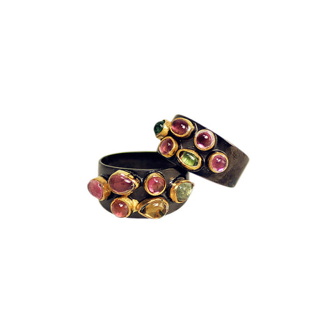 gun metal finish ring with colourful tourmaline stones in a gold bezel effect